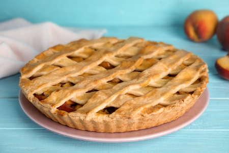 Delicious fresh peach pie on light blue wooden table, closeup 版權商用圖片