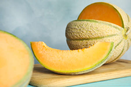 Tasty fresh melon on wooden board, closeup