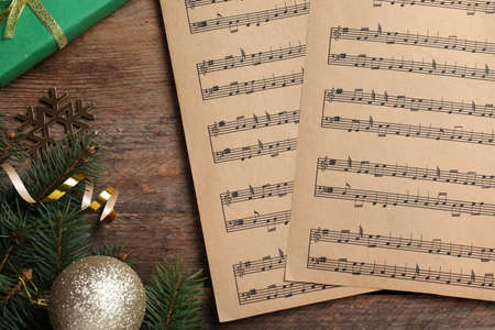 Flat lay composition with music sheets on wooden background. Christmas celebration Stock Photo