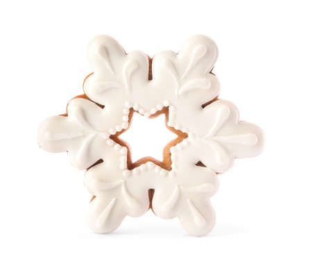 Snowflake shaped Christmas cookie isolated on white