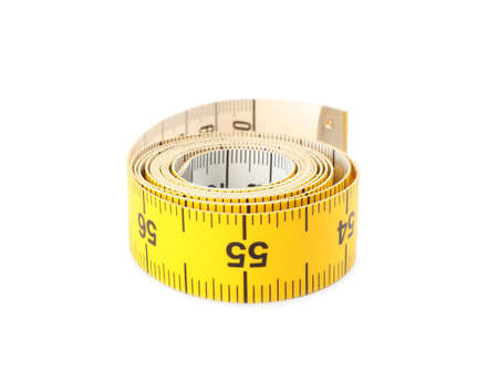 Rolled yellow measuring tape isolated on white