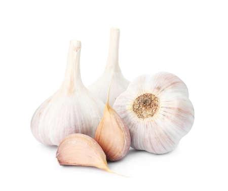 Fresh organic garlic bulbs and cloves on white background