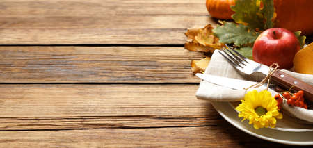 Happy Thanksgiving Day, banner design. Festive table setting on wooden background, closeup with space for text