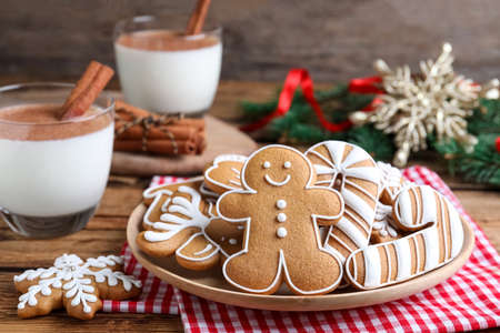 Delicious gingerbread Christmas cookies on table, closeup
