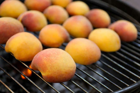 Modern grill with tasty juicy peaches, closeup