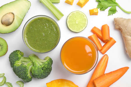 Delicious vegetable juices and fresh ingredients on white background, top view