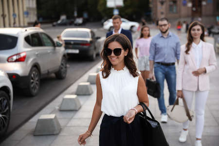Young woman walking on modern city street