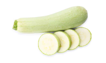 Cut and whole green ripe zucchinis on white background, top view