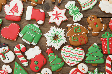 Many different delicious Christmas cookies on wooden table, flat lay