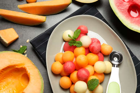 Flat lay composition with melon and watermelon balls on table