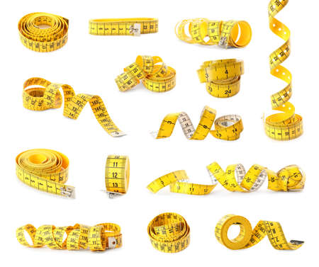Set of yellow measuring tapes on white background
