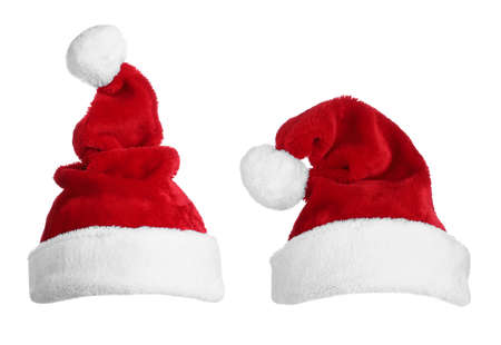Two red Santa hats on white background Stock Photo