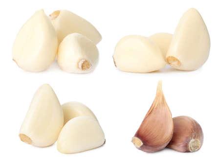 Set of fresh garlic cloves on white background