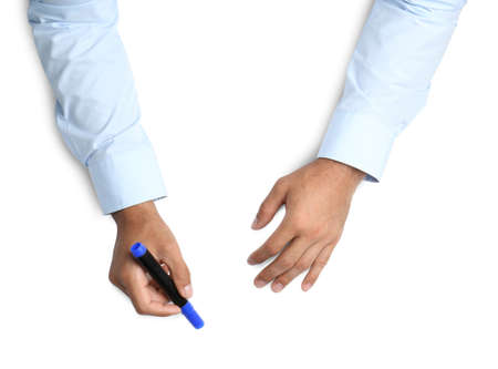 Man with marker on white background, top view. Closeup of hands