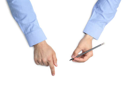 Man with pencil on white background, top view. Closeup of hands