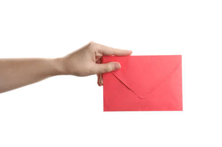 Woman holding red paper envelope on white background, closeup Stok Fotoğraf