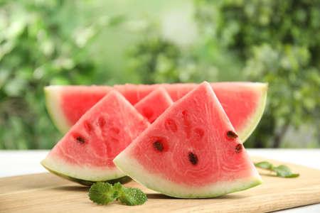 Slices of ripe juicy watermelon on wooden board