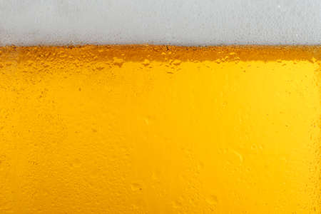 Glass of tasty beer with foam, closeup Stockfoto