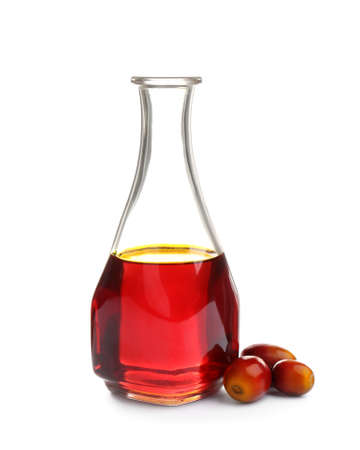 Palm oil in glass bottle and fruits isolated on white