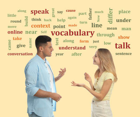 Man and woman talking surrounded by word cloud on yellow background 免版税图像