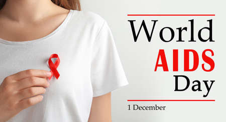 World AIDS Day poster. Woman with red awareness ribbon and text on light background, closeup