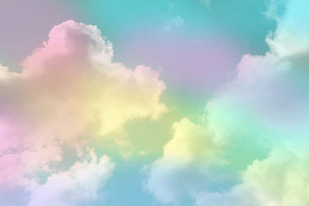 Fantasy world. Picturesque view of beautiful magic sky with fluffy clouds, toned in pastel rainbow or unicorn colors Banco de Imagens
