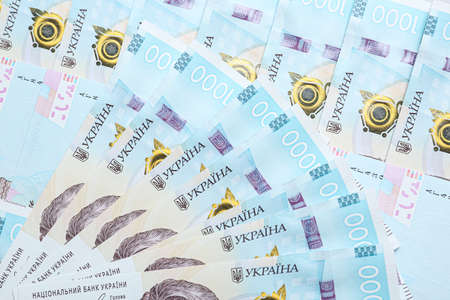 Closeup view of Ukrainian money as background. National currency