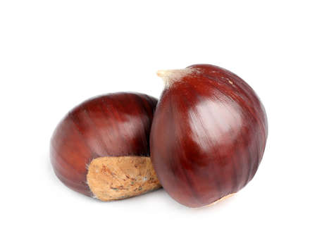Fresh sweet edible chestnuts on white background