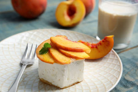 Delicious dessert with peach slices on plate, closeup