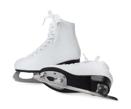 Pair of figure ice skates isolated on white Foto de archivo