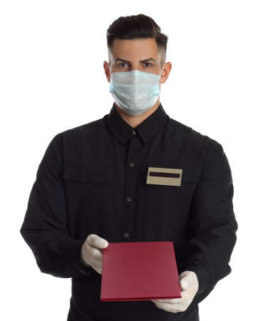 Waiter in medical face mask with menu on white background