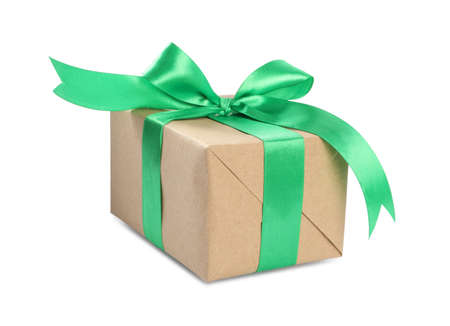Christmas gift box decorated with green bow isolated on white Imagens
