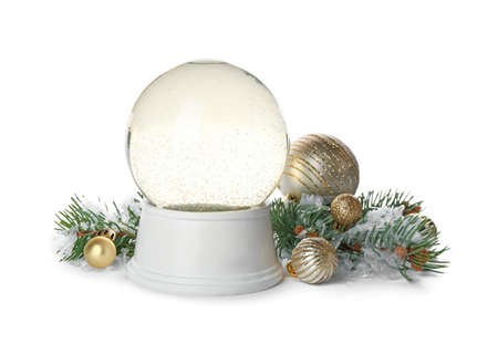 Beautiful empty snow globe, Christmas balls and fir branches on white background Stock Photo