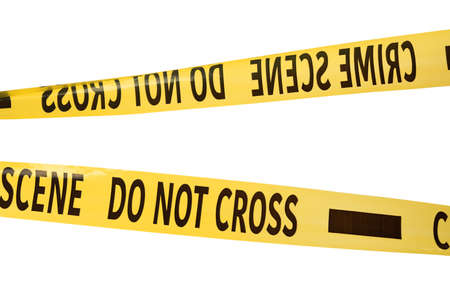 Yellow crime scene tapes isolated on white Stock Photo