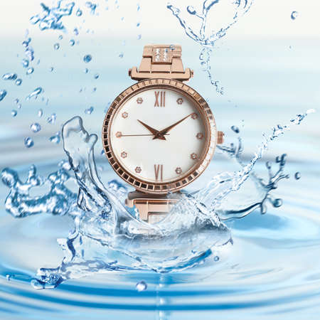 Luxury women's watch in water splashes demonstrating its waterproof