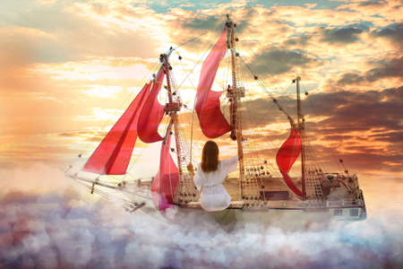 Dream world. Sailing ship with beautiful girl on board floating among wonderful fluffy clouds Banque d'images