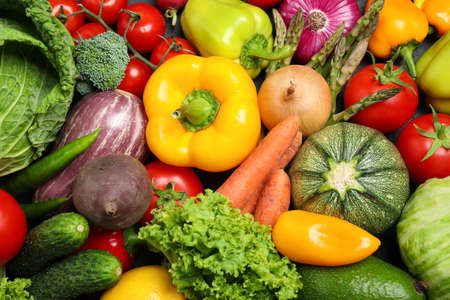 Different fresh vegetables as background, top view