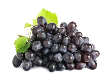 Bunch of fresh ripe juicy dark blue grapes with leaves isolated on white