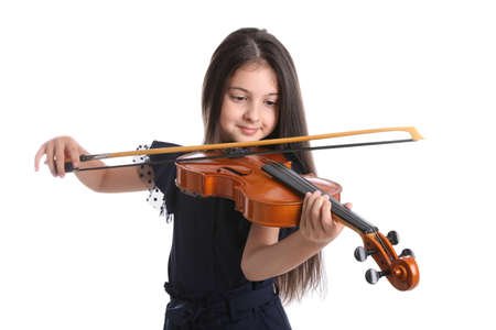 Preteen girl playing violin on white background