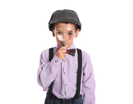 Little boy with magnifying glass playing detective on white background