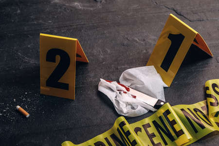 Crime scene markers and evidences on black background
