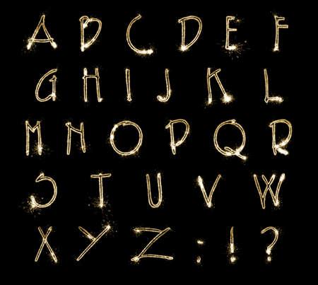 Set with letters made of sparkler on black background