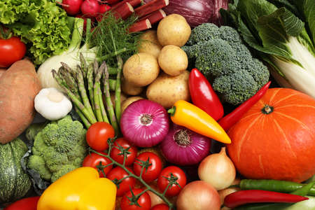 Different fresh vegetables as background, closeup view Stockfoto