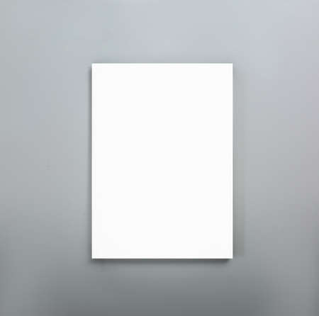 Blank poster on gray wall. Mockup for design