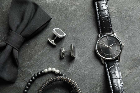Flat lay composition with luxury wrist watch on black background Stock Photo