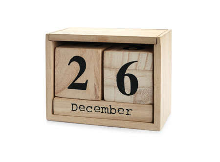 Wooden block calendar with Boxing Day date isolated on white