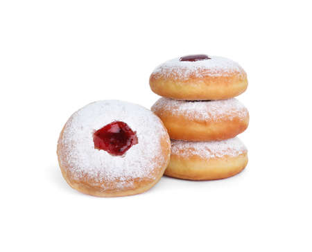Hanukkah donuts with jelly and sugar powder on white background