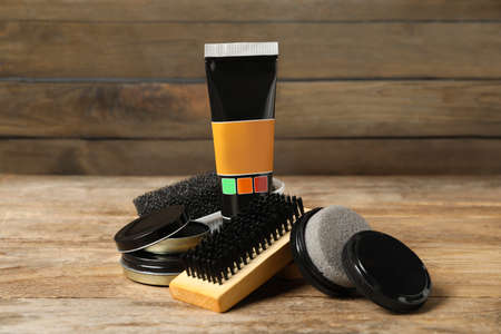 Composition with shoe care accessories on wooden table