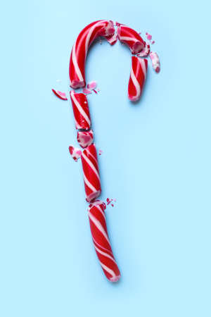 Crushed Christmas candy cane on light blue background, top view Stok Fotoğraf