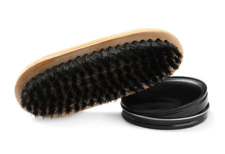 Polish with brush on white background. Shoe care accessories